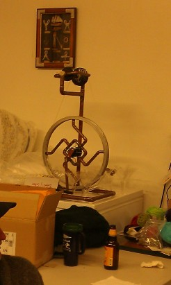Steampunk style spinning wheel made by Fearless Daughter's boyfriend.