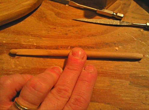 "This hook is hand sanded to be consistently a size ""J"" all the way through from head to tail. This photo was taken near the middle stages of making it."